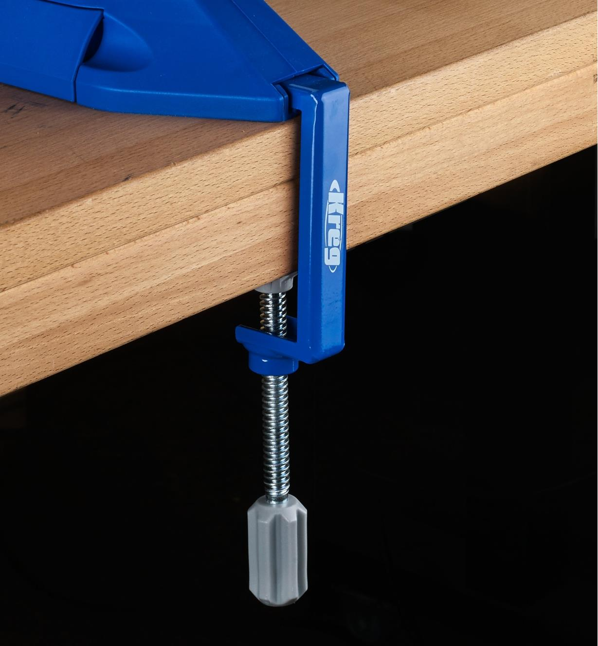 The table clamp being used to secure a Kreg pocket-hole jig to a workbench