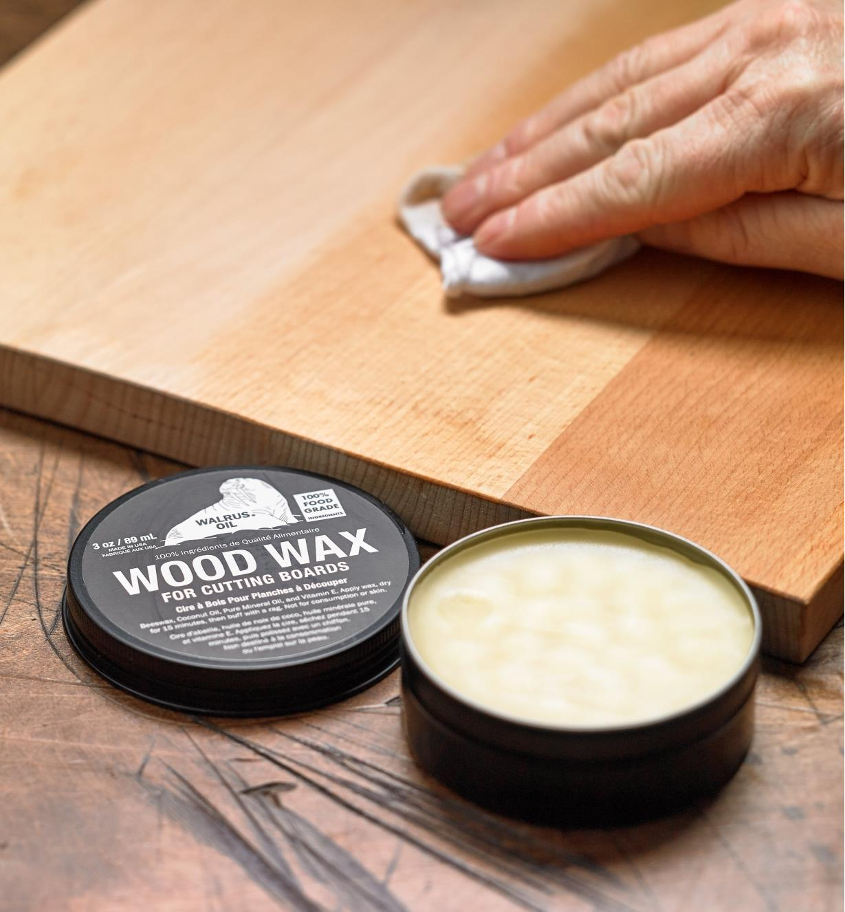 Applying Walrus Oil cutting-board wax to the unfinished surface of a newly made wooden cutting board
