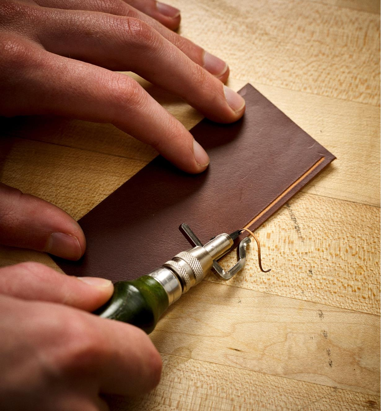 Using the Combination Groover/Creaser to cut a groove in leather