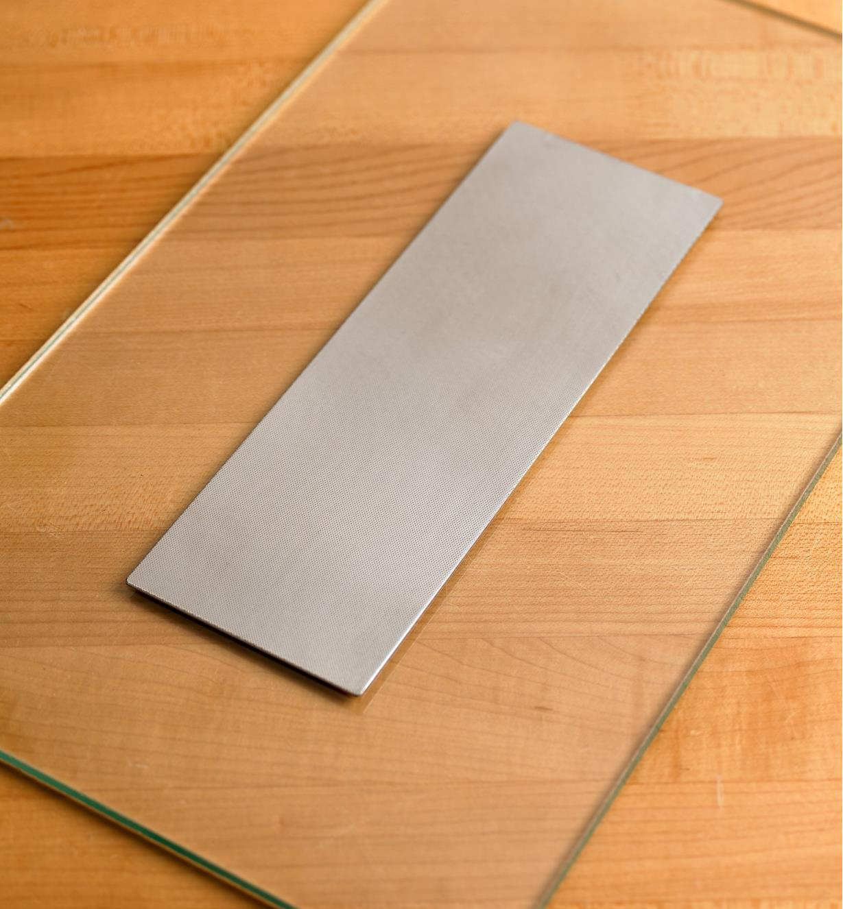 Diamond abrasive sheet affixed to a glass lapping plate