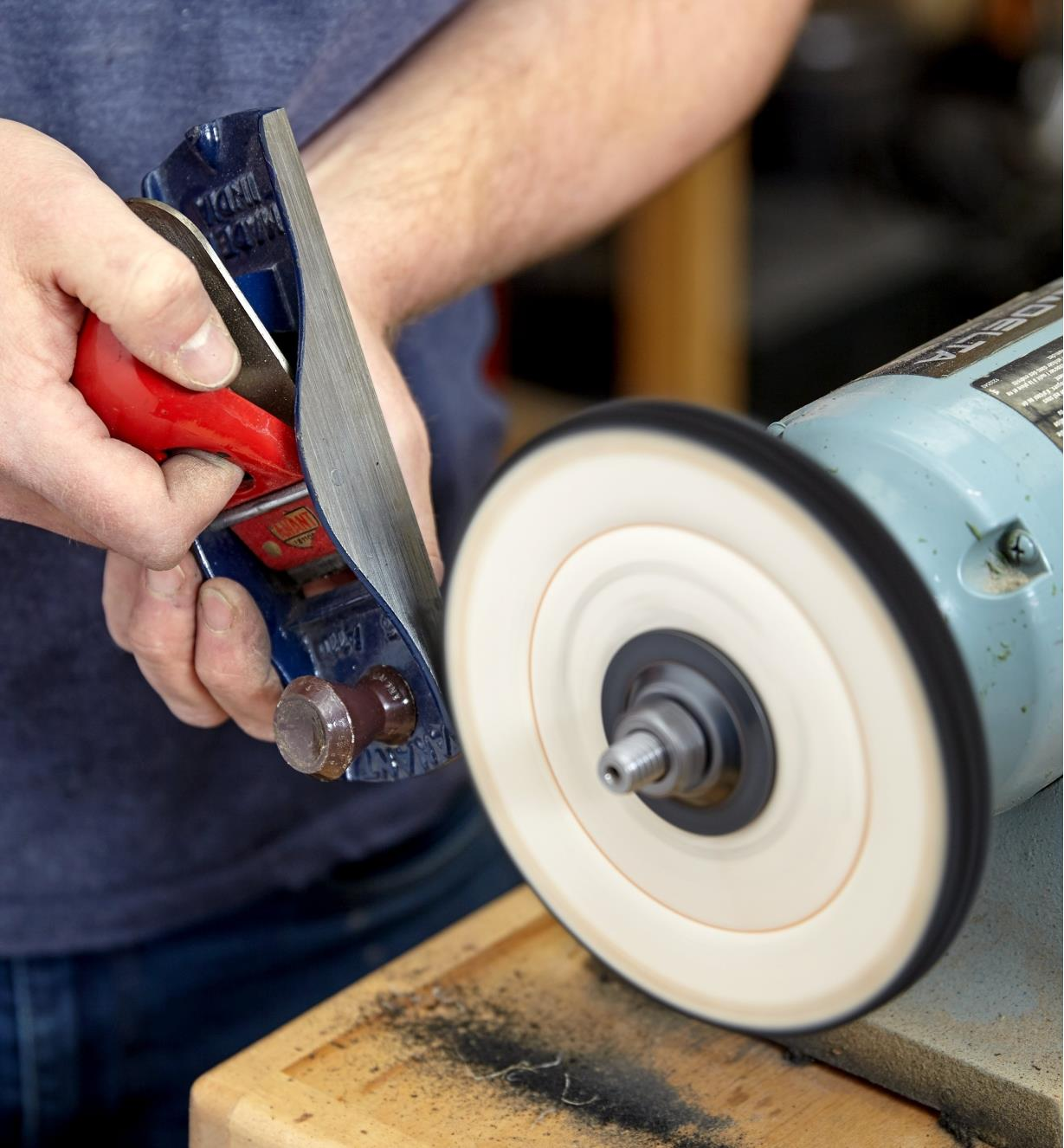 Polishing a block plane cheek with the cloth buffing wheel