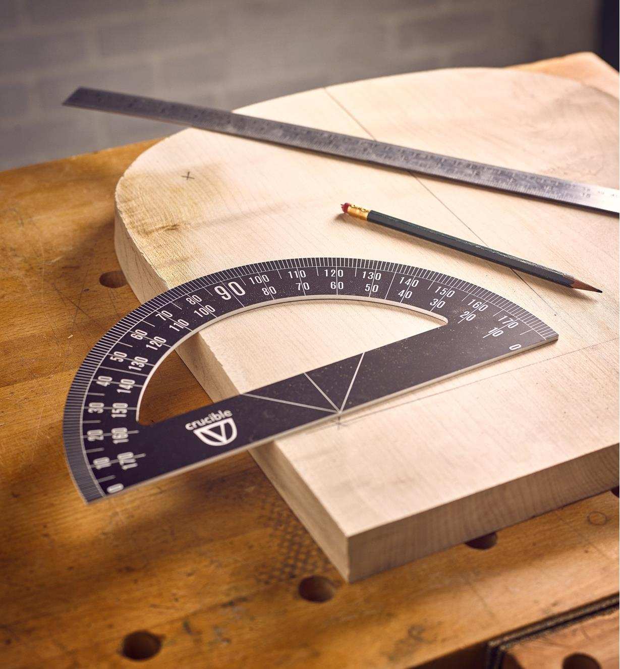 The Crucible protractor and drawing tools with a workpiece
