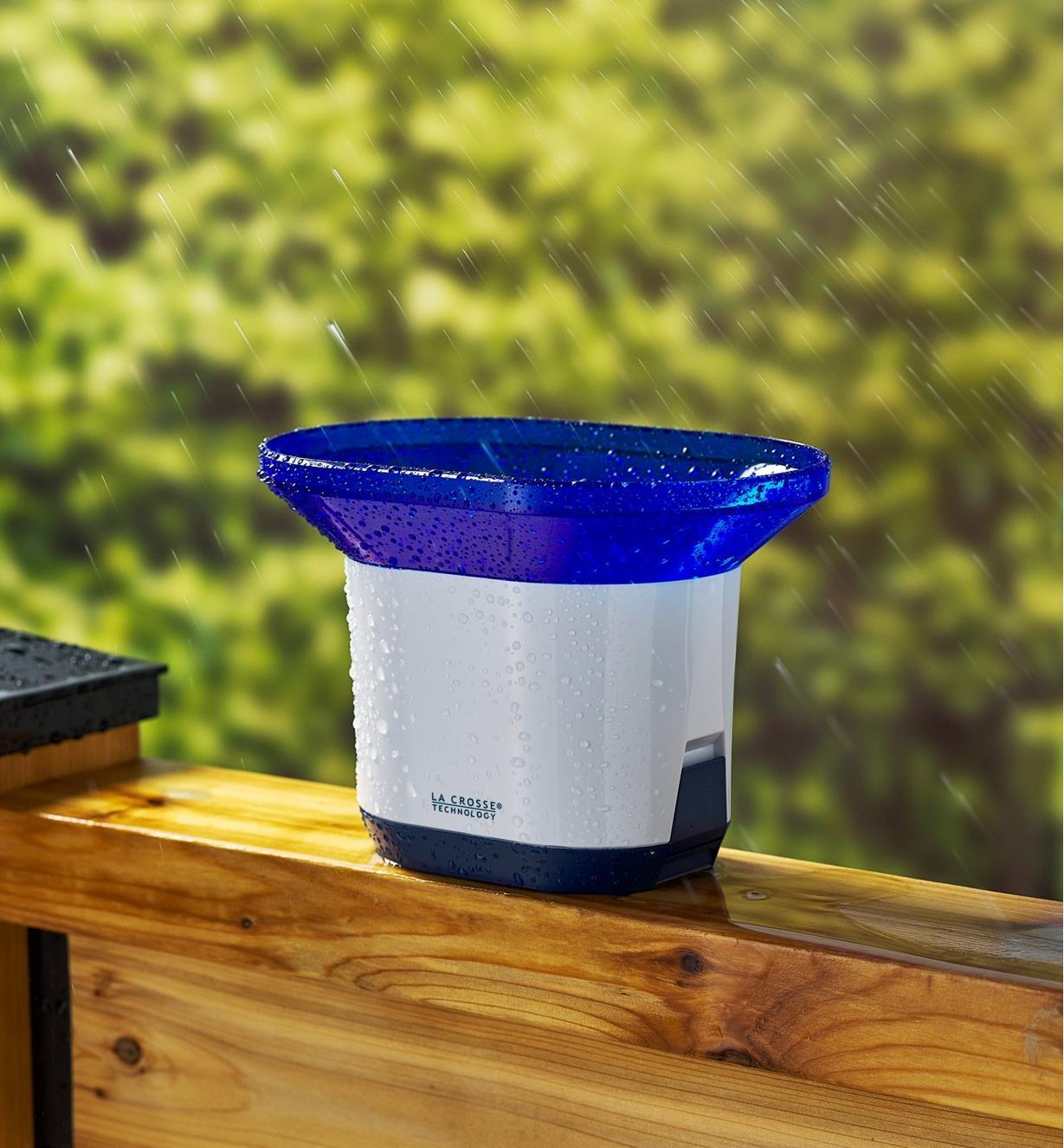 Rain bucket for the wireless rain station on a deck railing