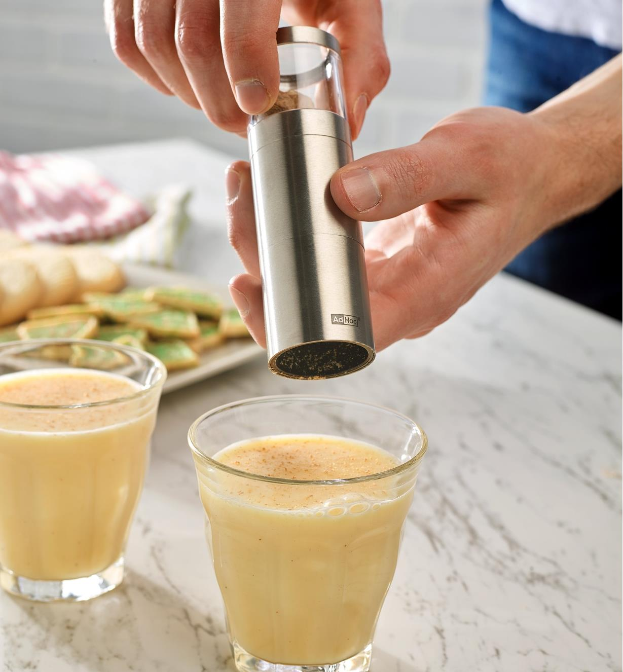Using the Nutmeg Grinder over cups of eggnog