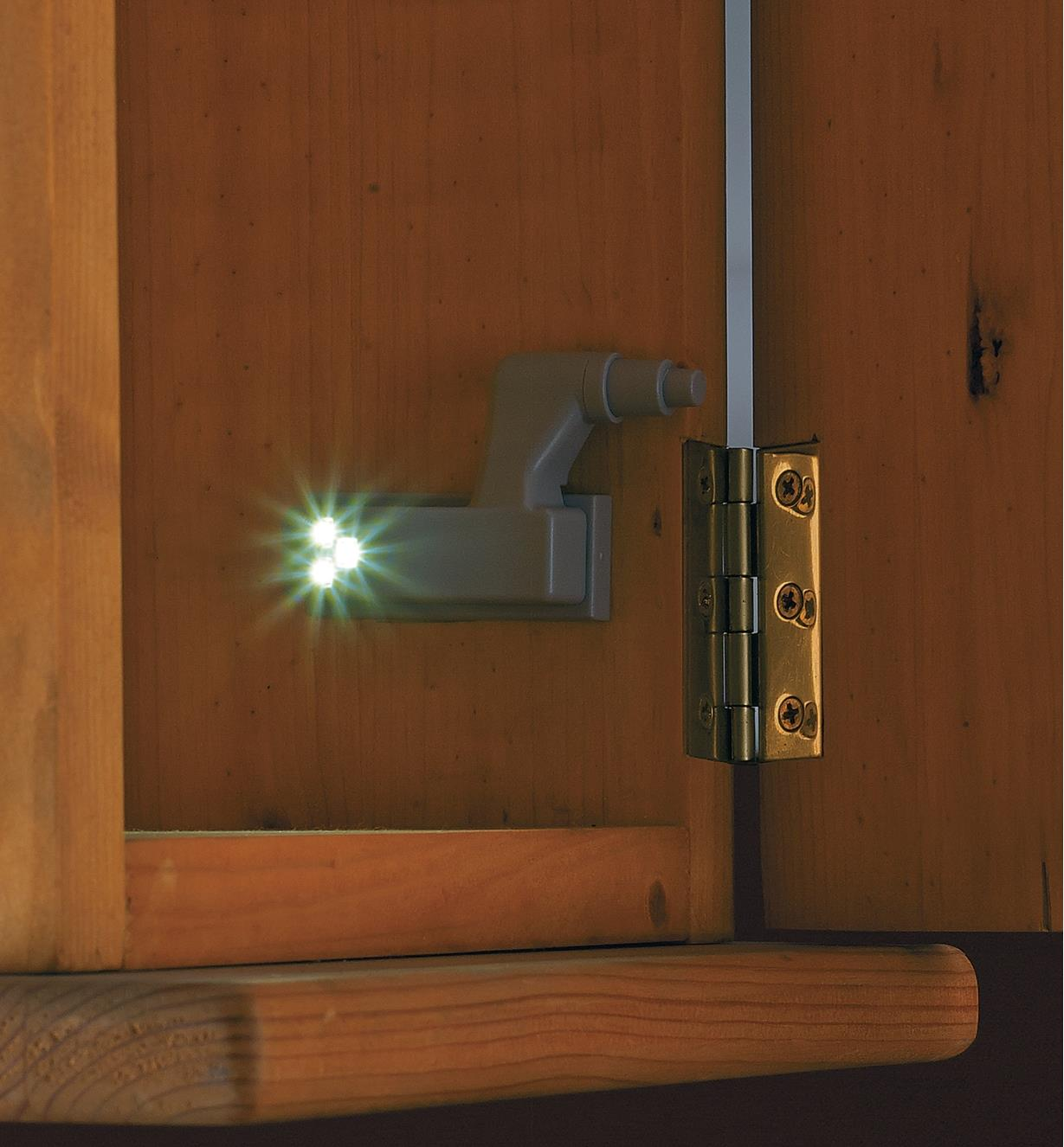 Wireless Hinge LED mounted inside a cabinet