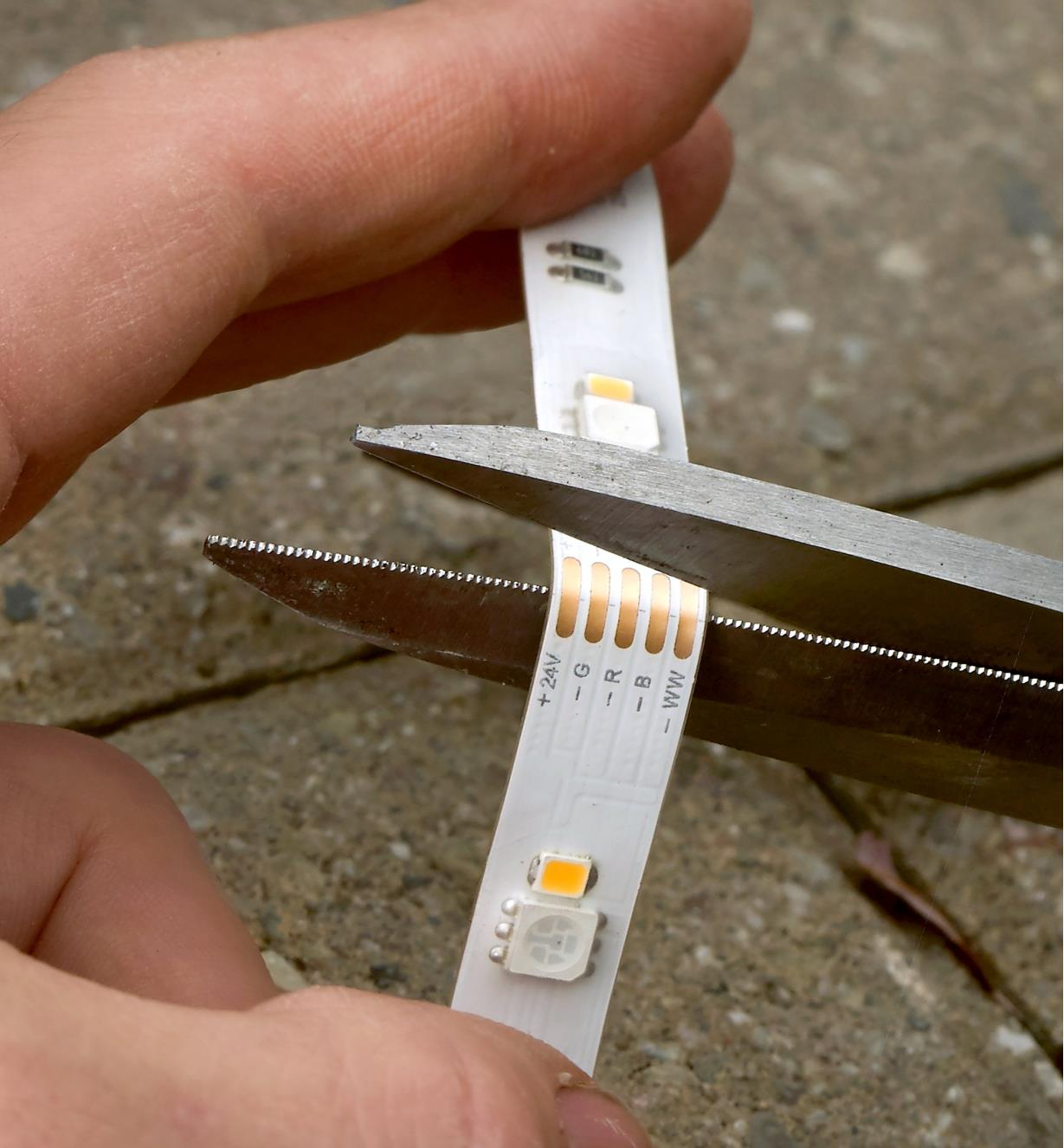 LED tape lighting being cut to length for a customized installation
