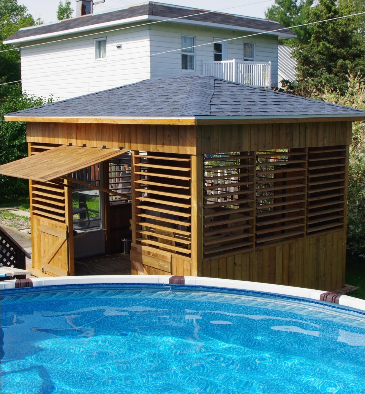 Example of louvers installed on a backyard pool house