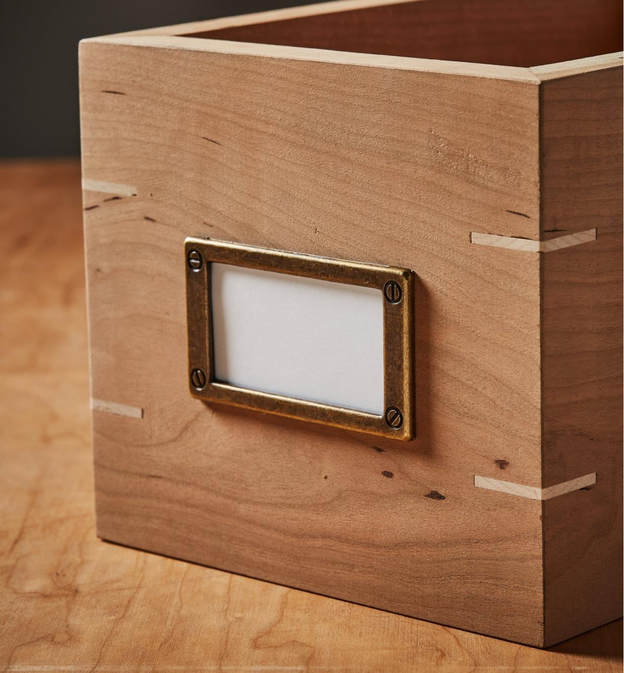 Card frame installed on a box