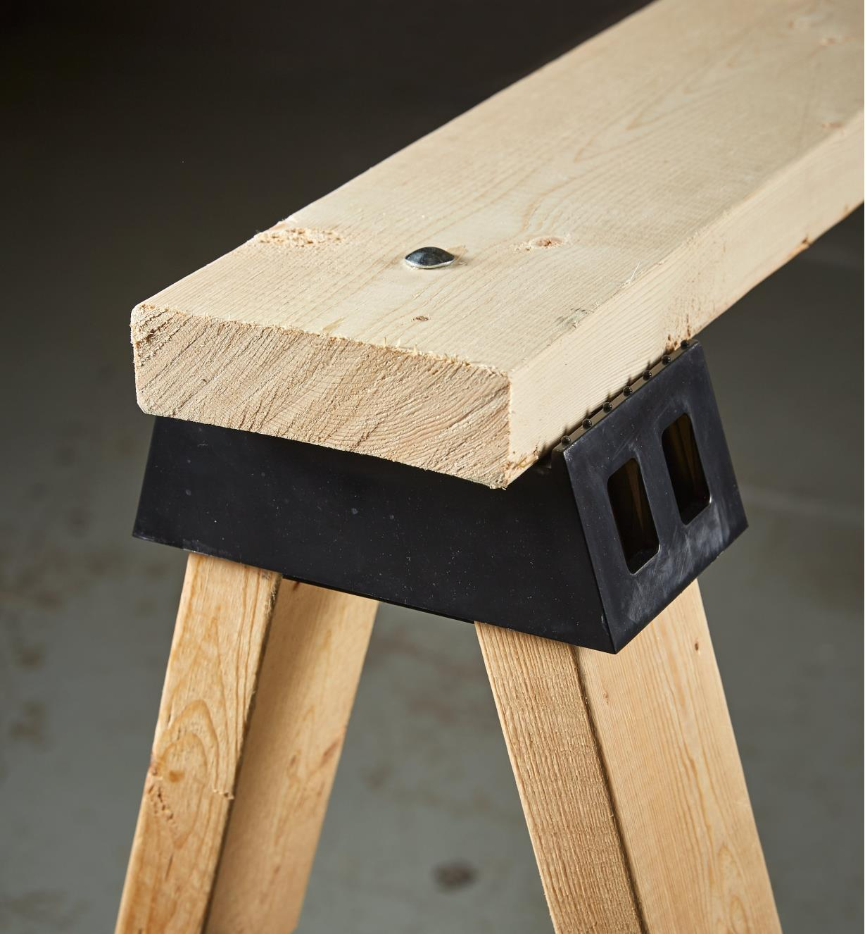 One end of a sawhorse made with a sawhorse bracket
