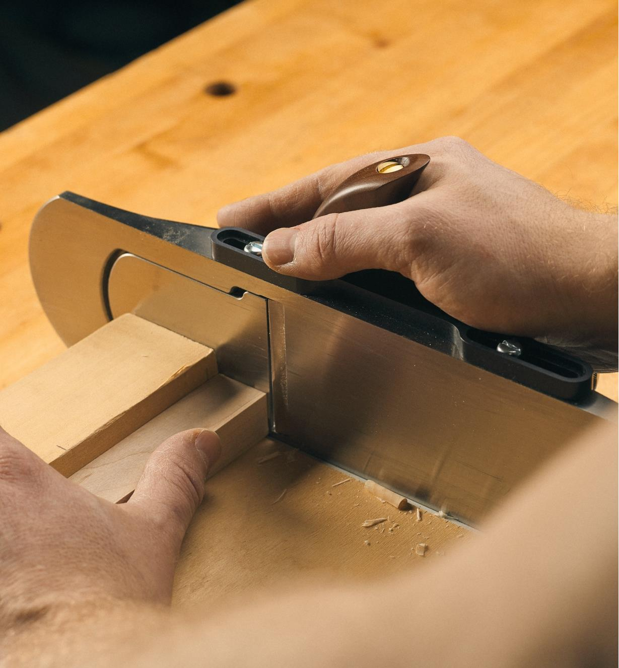 Shooting grip and plane being used with a shooting board to square the end of a piece of wood