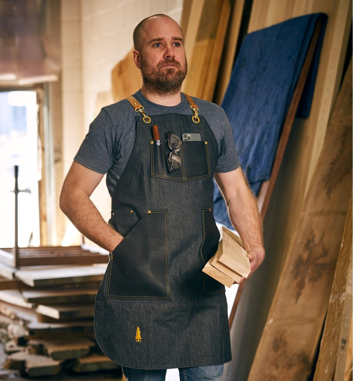 A man wearing the All-Purpose Apron in a workshop