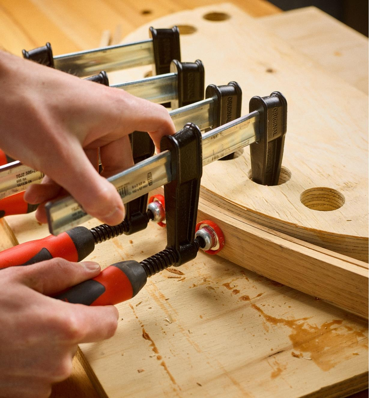 """Bessey 2 1/2""""  light-duty FA clamps used to clamp a curved piece of wood"""