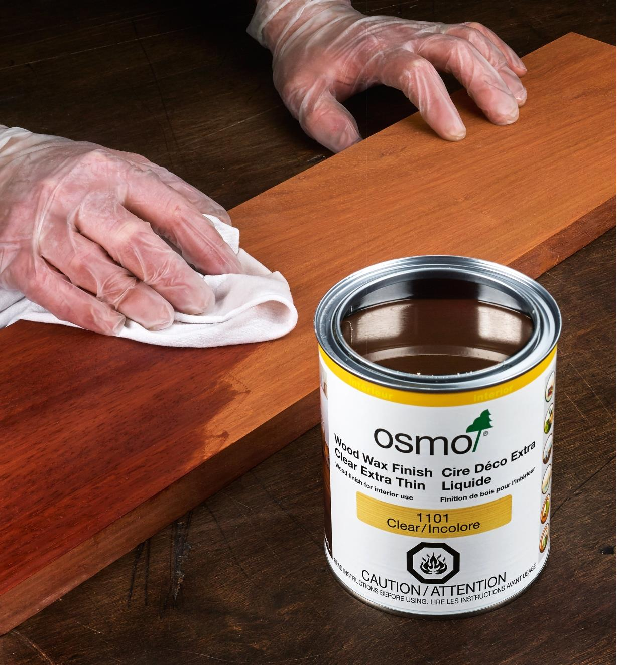 Using a cloth to apply Osmo extra-thin wood wax to a wood surface