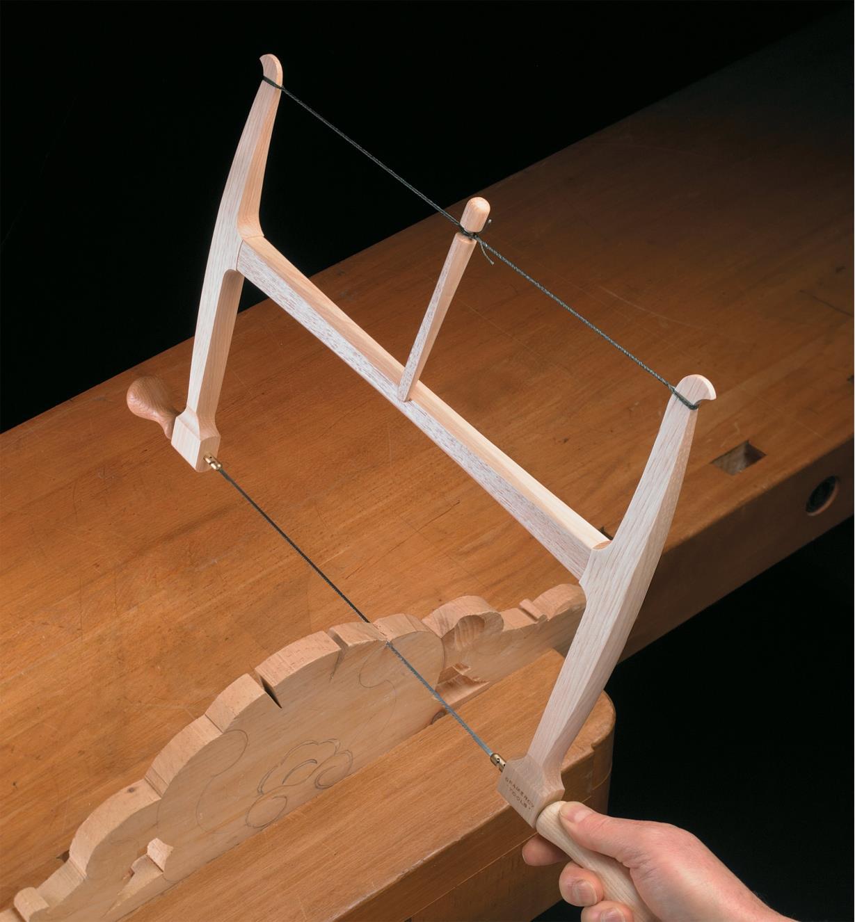 Cutting into a workpiece with a Gramercy Bow Saw