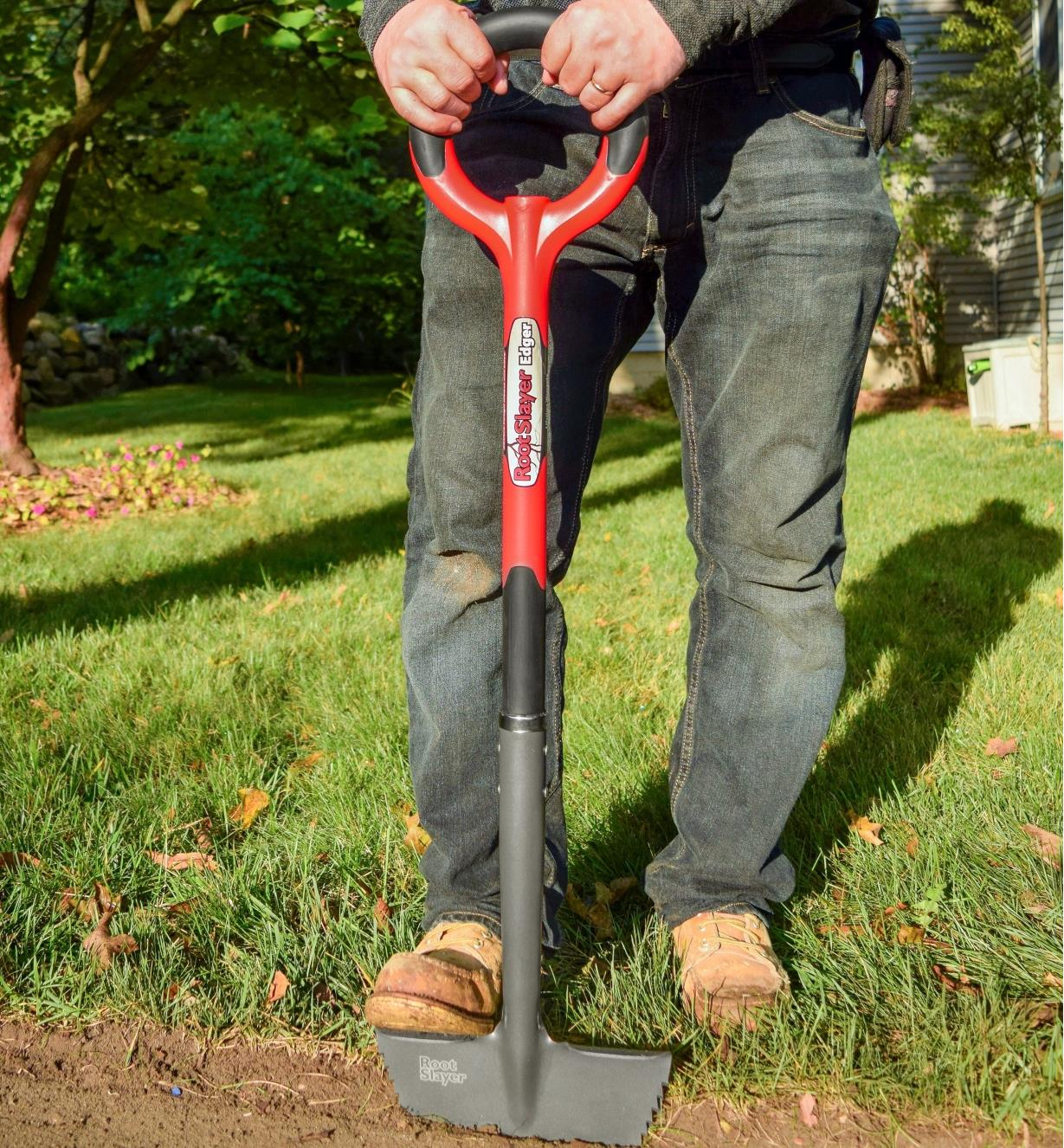Removing a section of sod from a lawn, using the root-cutter lawn edger to cut a neat, straight edge