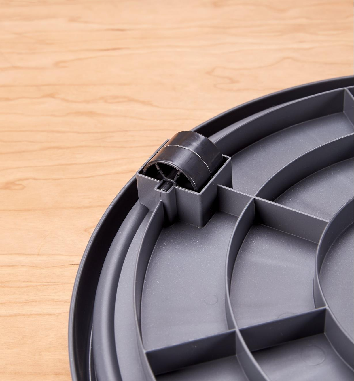 Close view of the rollers on the underside of the Elho rolling pot saucer
