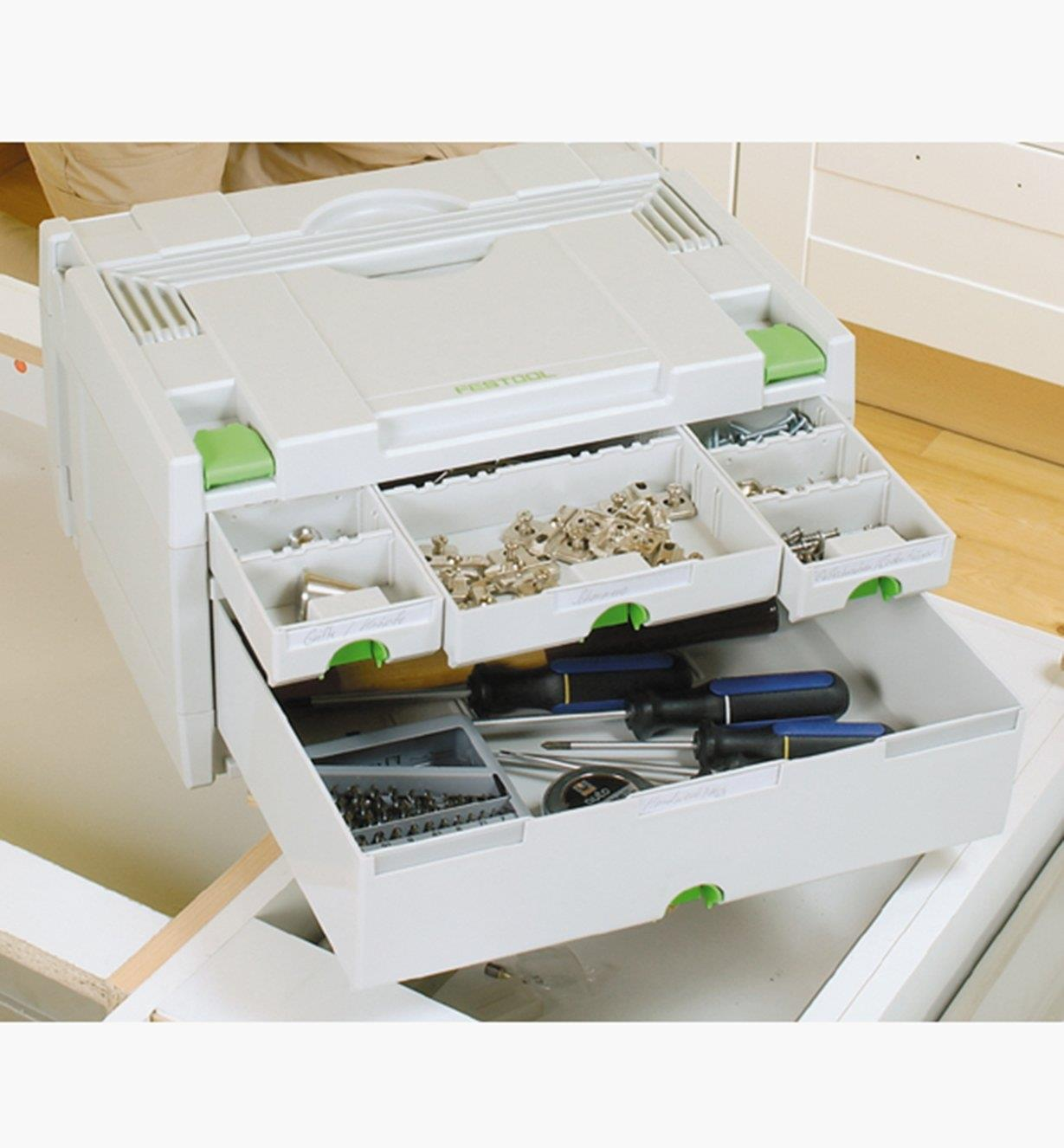 A four-drawer Sortainer with all drawers pulled open to show an organized assortment of hardware and tools