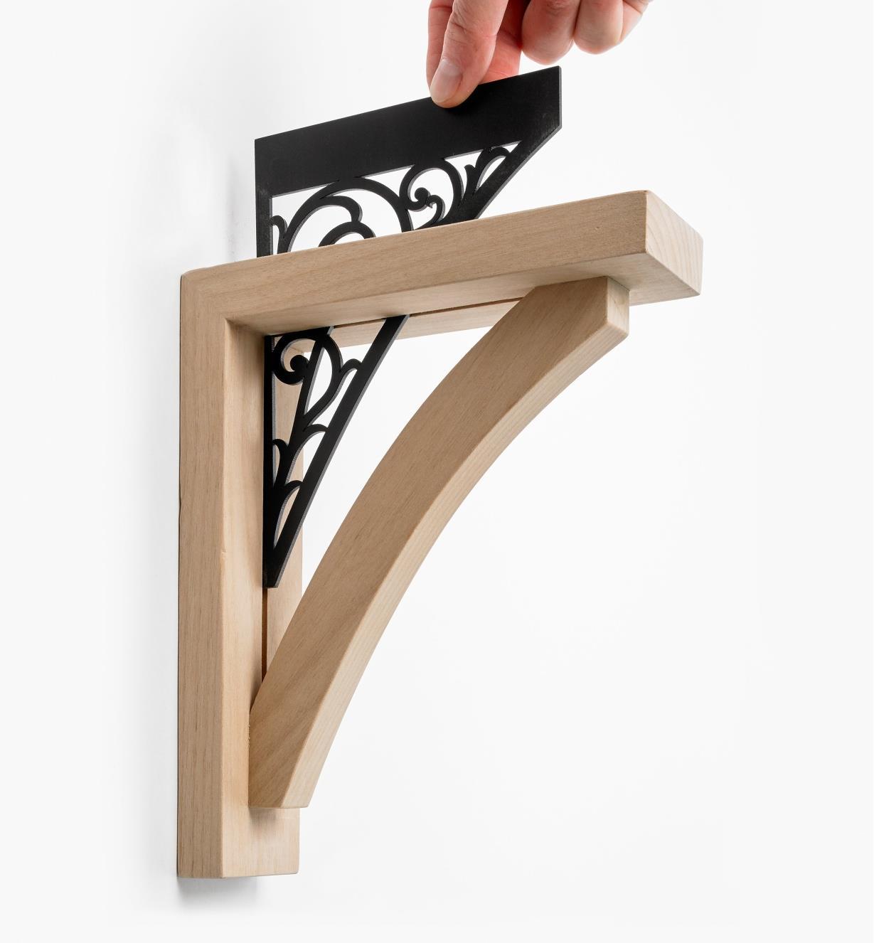 Placing the fiberboard insert in the Scroll Wooden Shelf Bracket