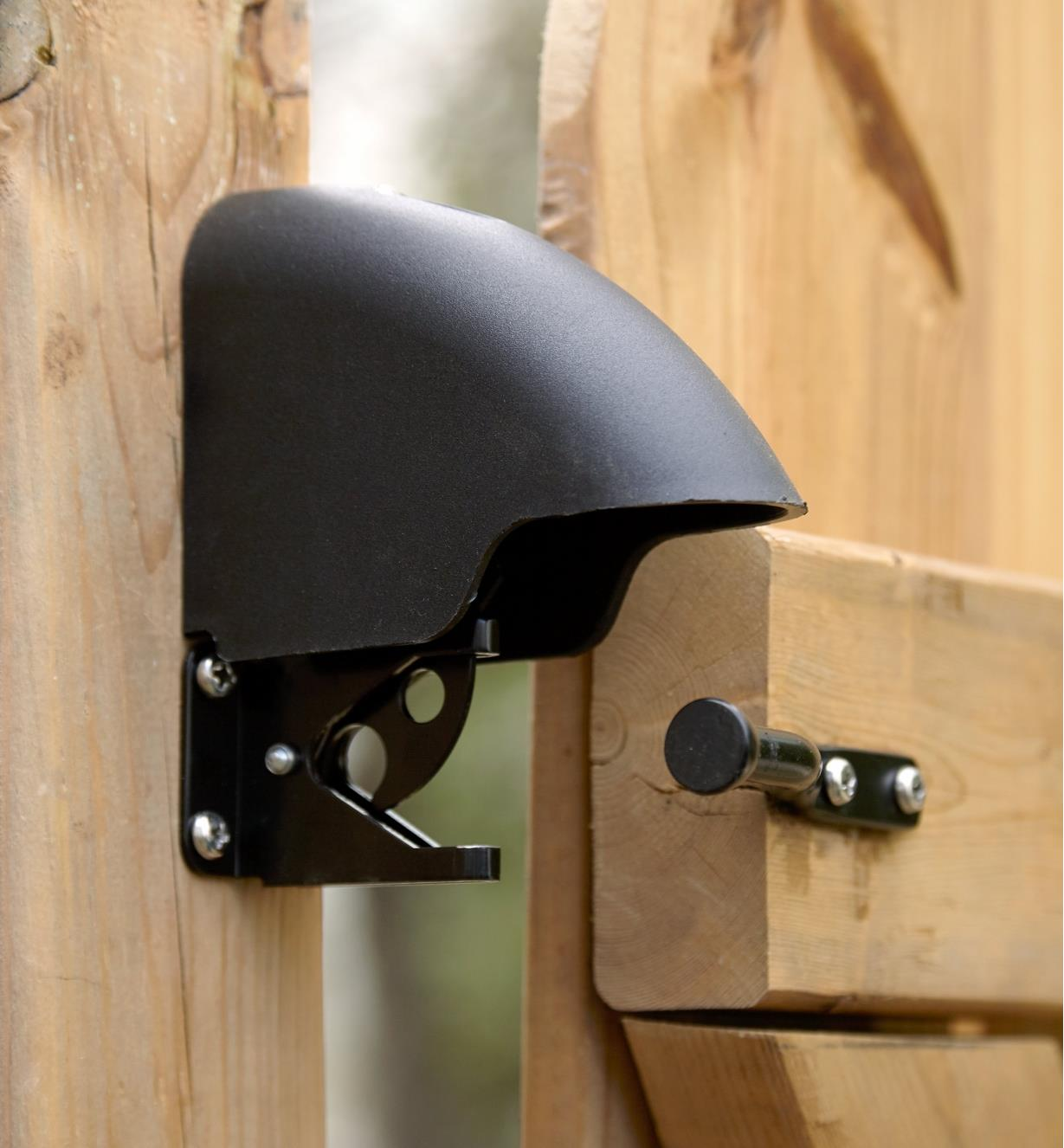 Cover protects the latch assembly of the keyless gate lock