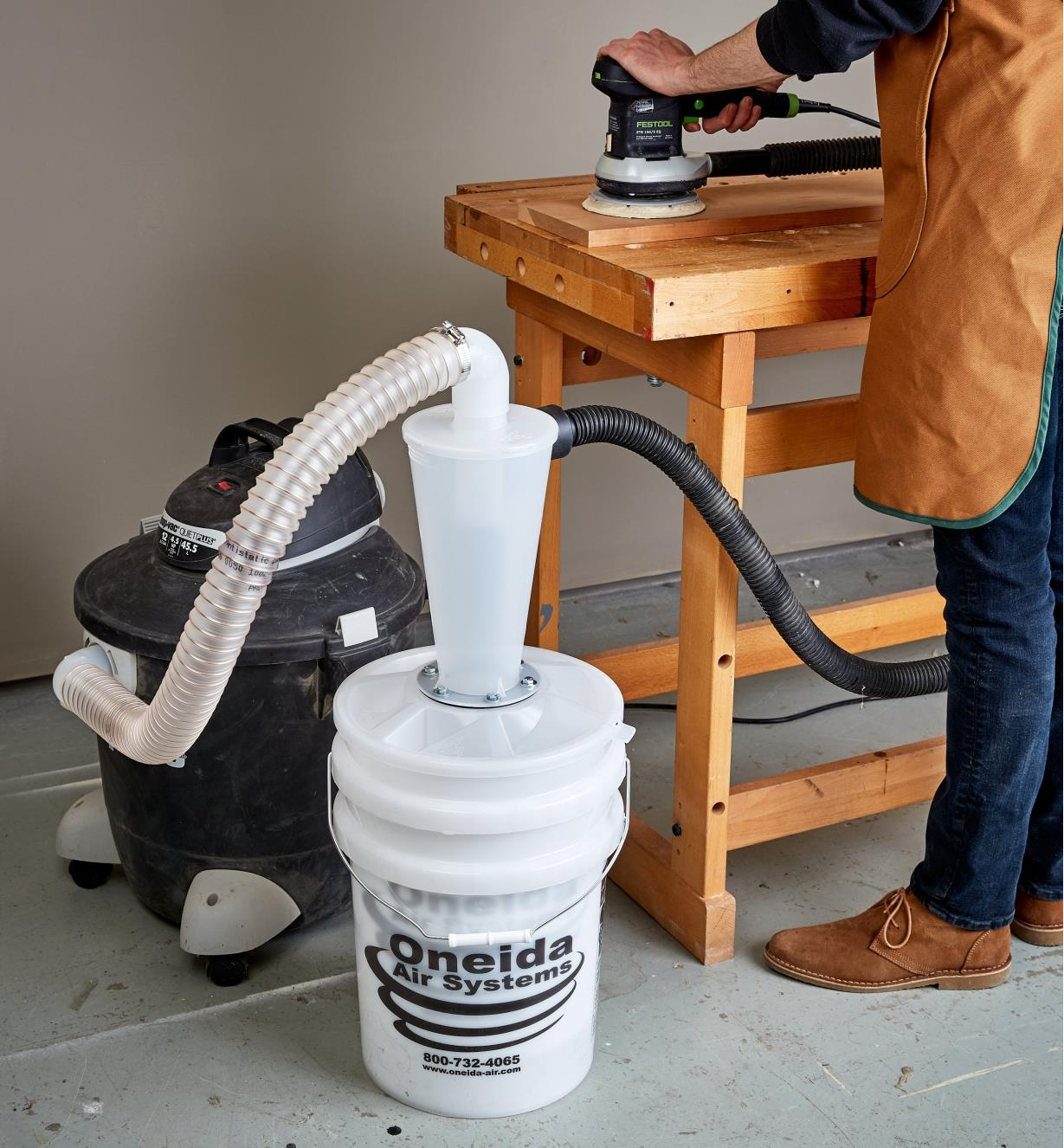 Dust Deputy Deluxe hooked up between a shop vacuum and a sander