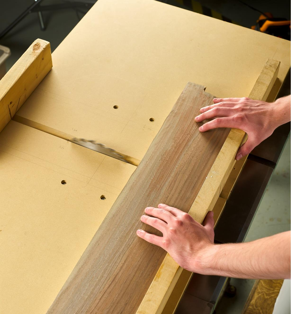 Cutting stock on a table saw using a sled made with two Zeroplay miter bars