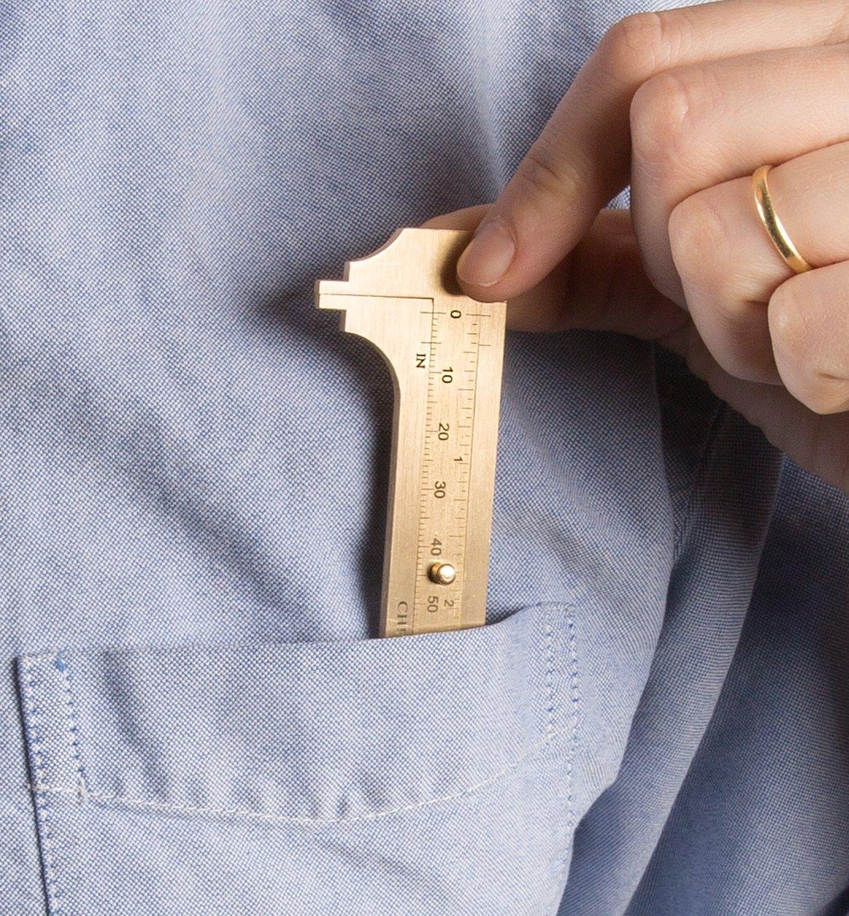 Slipping a Brass Caliper into a shirt pocket