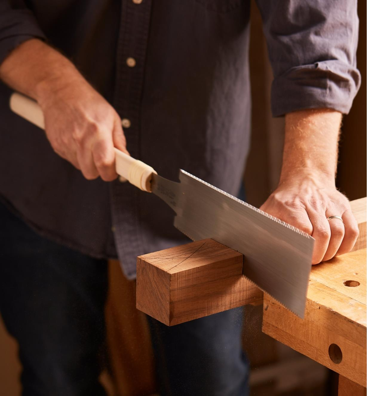 Sawing wood at the bench using a Japanese traditional ryoba saw