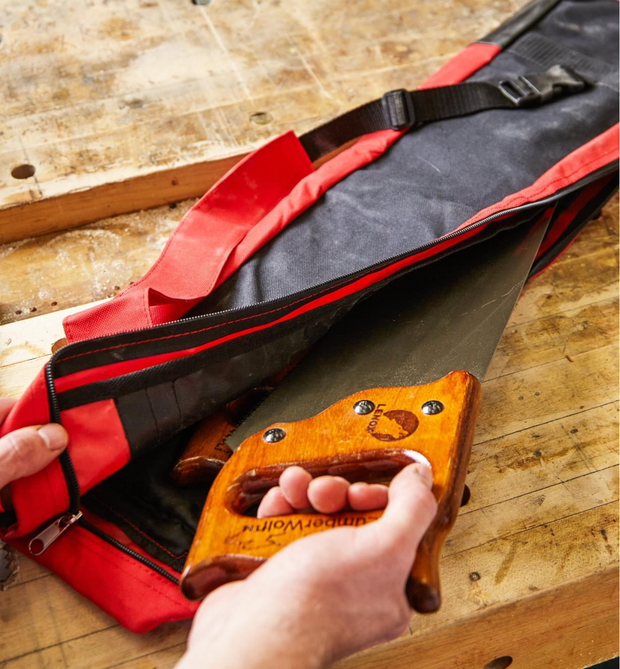 Placing a saw in the Carpenter's Saw Bag