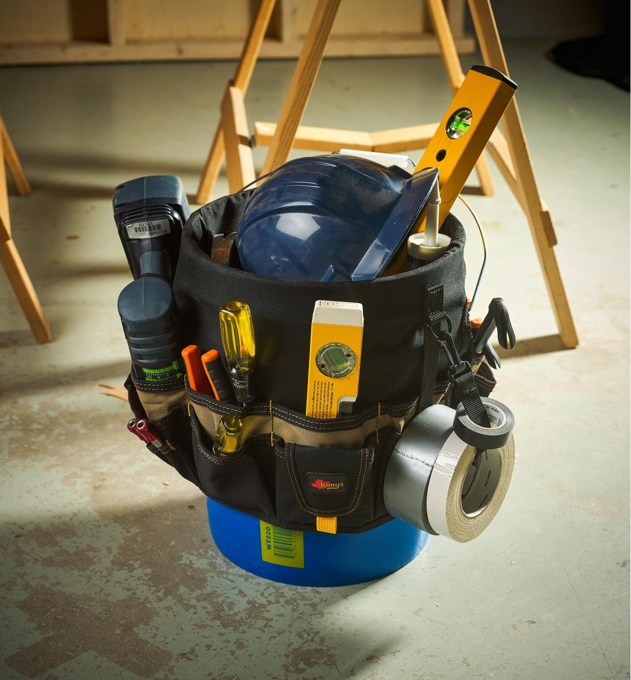 The 48-pocket tool carrier filled with tools and mounted on a bucket