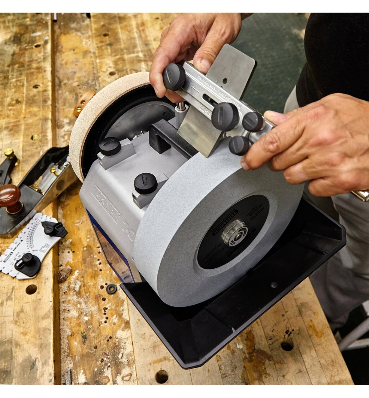 Set in a square-edge jig, a plane blade is sharpened on a Tormek T-8 sharpening machine