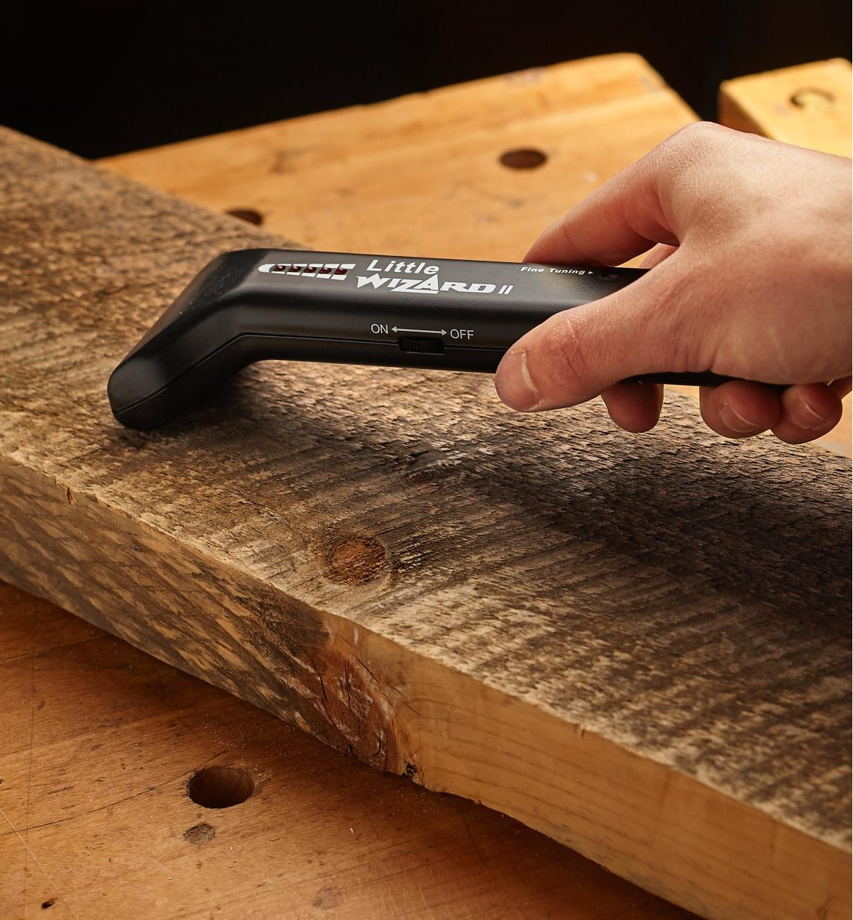Scanning a piece of lumber with the metal detector