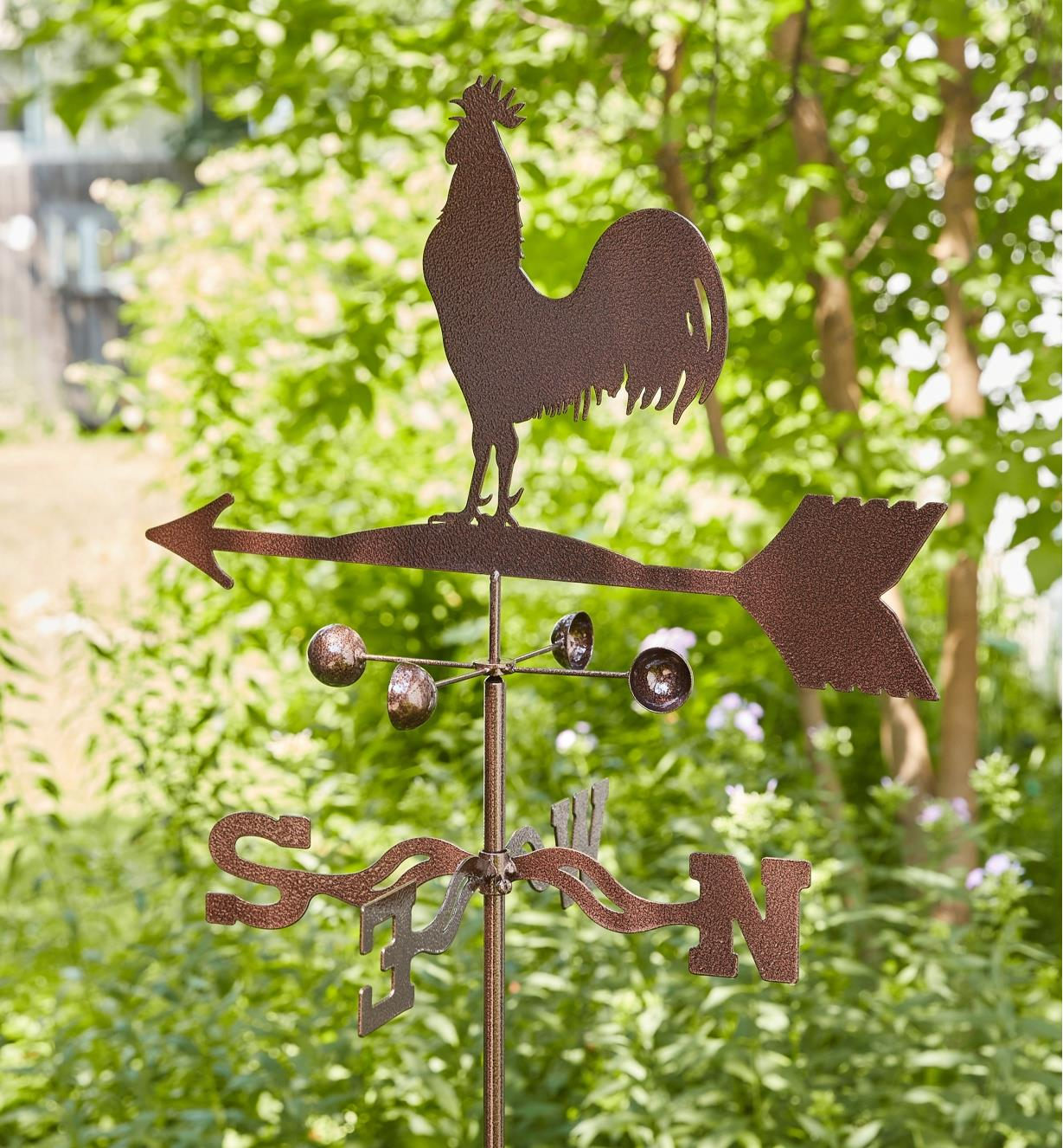 The topper, wind cups and directional of the rooster garden weathervane
