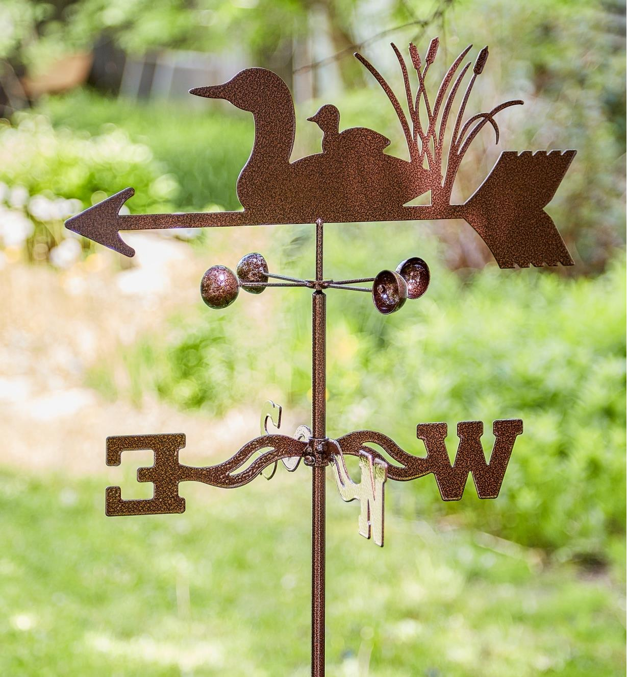 The topper, wind cups and directional of the loon garden weathervane