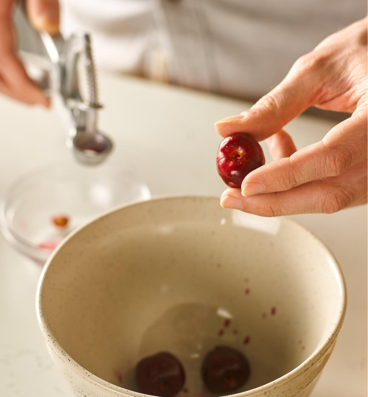 Close-up view of a cherry after removing the pit with the olive and cherry pitter