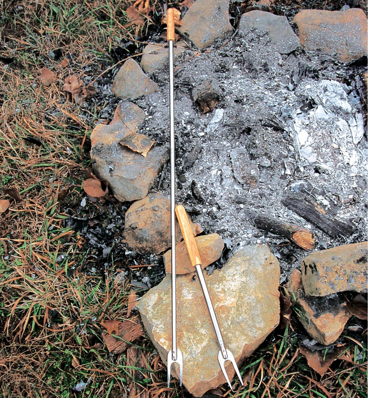 Two telescoping campfire forks, one extended to full length